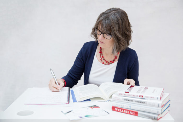 Charlotte Whitehead from Career Practic writing at her desk.