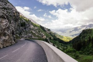 Photo of road through mountains by Alex Talmon, Unsplash.com