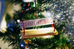 Merry Christmas ornament on tree