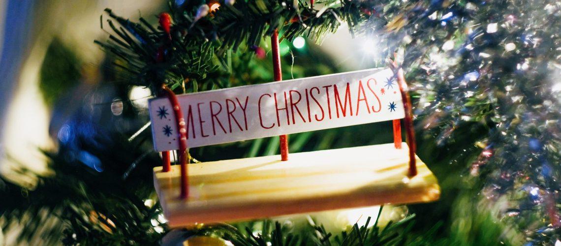 Merry Christmas ornament on tree